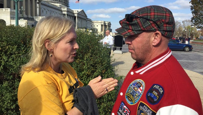 Sen. Kirsten Gillibrand, D-NY., talks to activist John Feal about the James Zadroga 9/11 Health and Compensation Act outside the U.S. Capitol on Nov. 17, 2001.