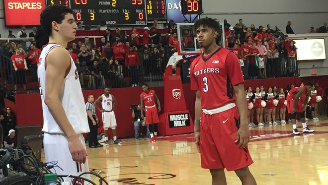 Corey Sanders (No. 3) is dialed on defense against St. John's point guard Federico Mussini, a fellow freshman.