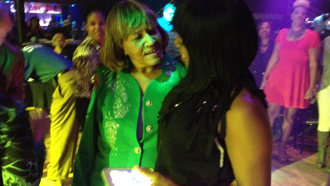 City Manager Anita Favors Thompson talks with woman attending her retirement celebration Thursday at The Moon.