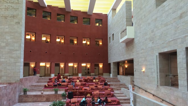 Students at Education City in Doha, Qatar, talk in a public area shared by Northwestern University and Carnegie Mellon, two American universities that have opened campuses in the building.