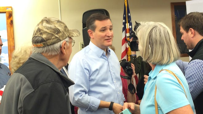 U.S. Sen. Ted Cruz, R-Texas, meets with supporters at a town hall in Harlan, Iowa Friday, Nov. 20, 2015.