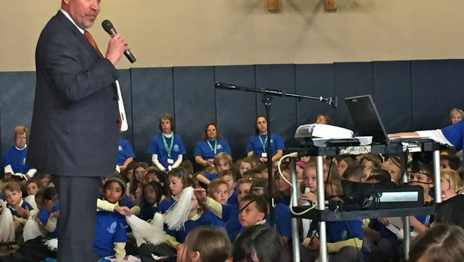 Congressman Tom MacArthur speaks at a pep rally at Our Lady of Good Counsel School on Friday.