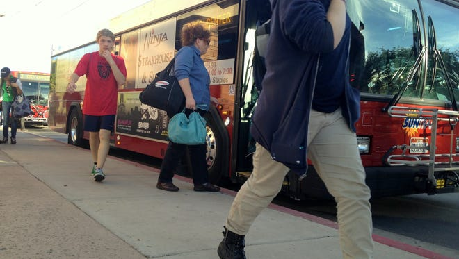 Residents hop aboard afternoon buses at the SunTran transit center in St. George. About 1,800 people ride SunTran buses each weekday, with ridership having increased in the past year thanks to the creation of new routes.