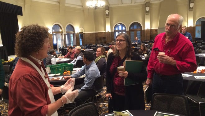 People get a taste of some local organic food at the Iowa Organic Conference, held at the Iowa Memorial Union from Sunday to Monday.