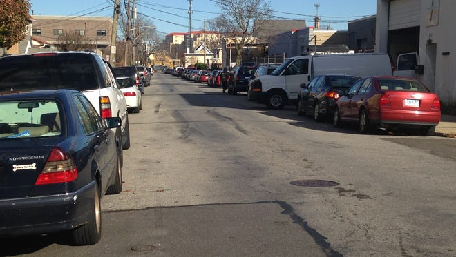 Plain Avenue in New Rochelle is lined with cars on both sides, making parking scarce.