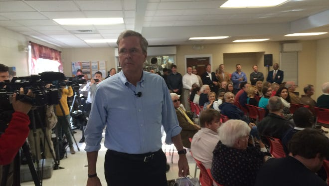 Former Florida Gov. Jeb Bush heads toward the podium in the dining hall at the Salvation Army's campus on Rutherford Street Tuesday.