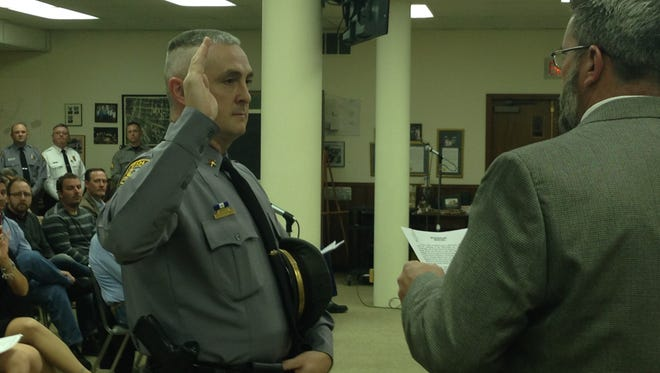 Hanover Borough Police Chief Chad Martin is sworn into his position by Mayor Ben Adams. Martin has worked for the department for 19 years.