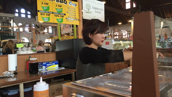 Lydia Kim opened Korean Style BBQ Cup Tuesday at Central Market in York.