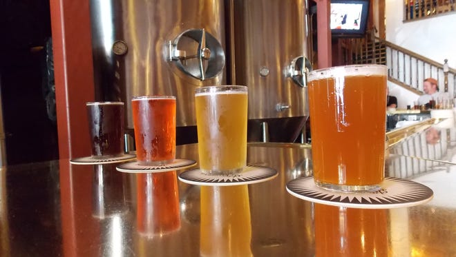 Published in print  Brewbaker's Brewing Company is bringing out its most popular craft beers for the festival, including their IPA and Sequoia Red. Pictured from left to right: Brewbaker's Sequoia Red, Raspberry Apple Cider, Pioneer Blonde Ale and IPA.  Stephanie Weldy