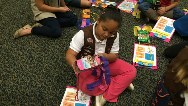 Gabriel LeBaugh, a second-grade student at Pine Meadow Elementary, participates in a Girl Scouts Florida Panhandle craft activity Nov. 21 in Building 21 of the University of West Florida campus.