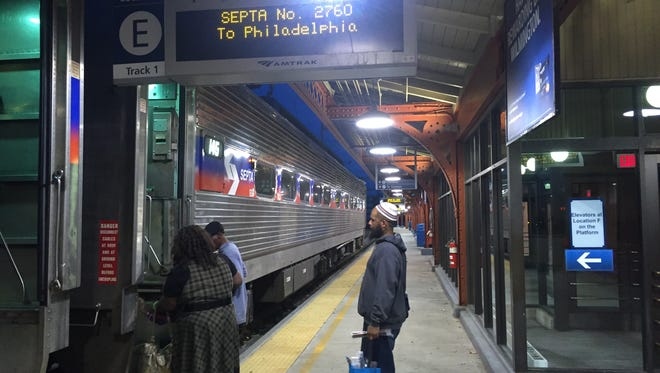 """Abdul Wali waits to board a SEPTA train in Wilmington Friday.  He said expanded weekday service is an """"excellent idea"""" but added there should be more late-night trains on Saturday too."""