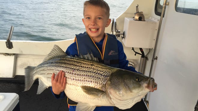 Julian Muermann, 9-years old of Lanoka Harbor, with his first striped bass. It measured 40 inches and weighed 24 pounds.