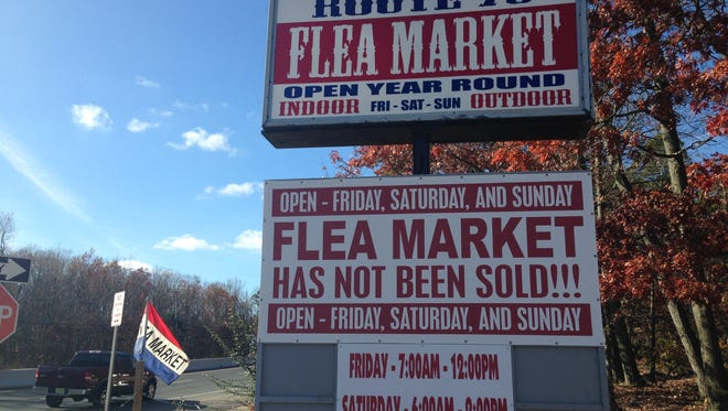 The sign at the entrance to the Route 70 Auction & Flea Market says the business has not been sold. The operators put the sign up in response to rumors about the property's development.