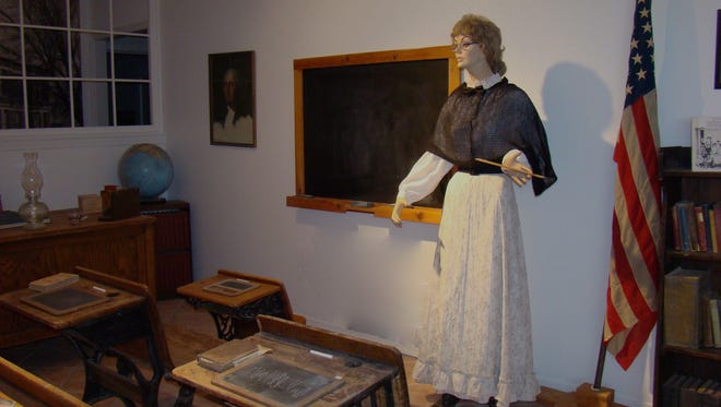 This Carrizozo Heritage Museum classroom exhibit shows how a classroom may have looked before education was moved from private homes into public buildings.