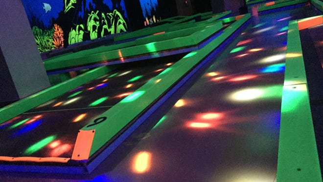 Inside Glowgolf are 36 miniature golf holes and a laser maze.