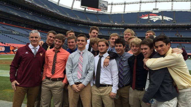 Members of the Windsor High School football team tour Sports Authority at Mile High on Tuesday before Saturday's Class 4A state championship game.