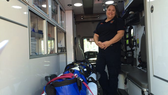 Paramedic and Field Training Officer Alicia Gagne shows off the cabin of a Sprinter-chassis ambulance