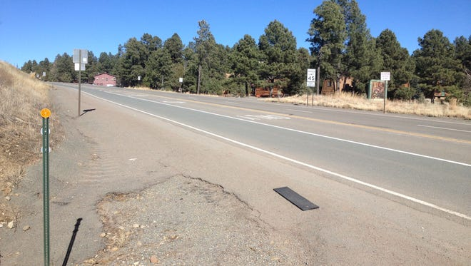 A high-speed confrontation between two motorists ended in a bloody fistfight near this stretch of  shoulder along New Mexico Highway 48 north of Ruidoso.