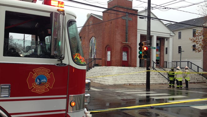 Wilmington fire crews inspect New Jerusalem Missionary Baptist Church on Dec. 2 following a blaze. The department is working to address overtime cost issues.