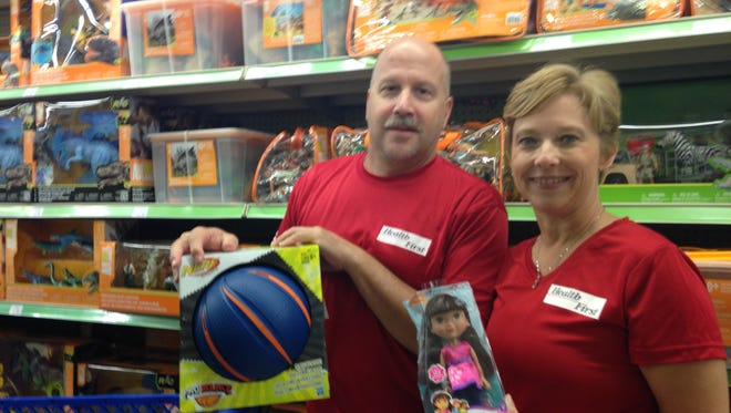 """Paula Just, human resources officer for Health First, and her husband, Randy Just, shop for gifts Health First is donating to the South Brevard Sharing Center's """"Children Without Christmas Toy Drive"""""""