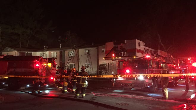 Crews battle a structure fire at Westall Apartments in North Asheville on Friday night.