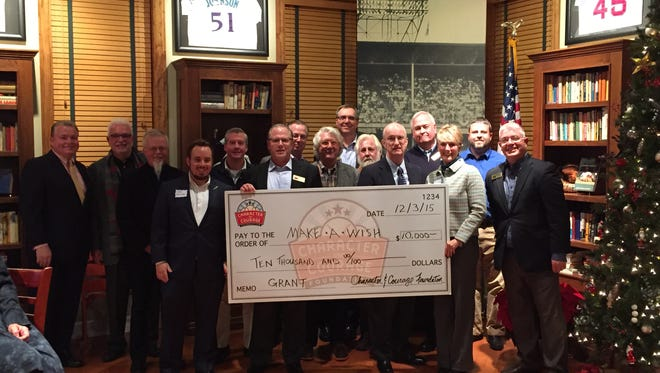 Character and Courage Foundation team members present a check to Make-A-Wish Foundation of Ohio, Kentucky and Indiana.