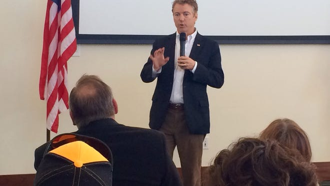 Kentucky Sen. Rand Paul, a Republican candidate for president, answers an audience member's question Friday in Waukee.