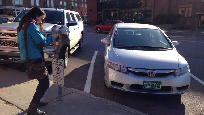 Kristin Daley of Williston pays for parking with a credit card on Saturday. Daley said she was unaware of the new Parkmobile app that was launched by the city of Burlington in November.