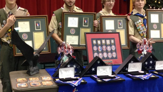 From left to right: Sean Sempowski, Evan Vink, Alex Gallant, and Hank Wyatt display their Eagle plaques presented to them at their Eagle Court of Honor Saturday.