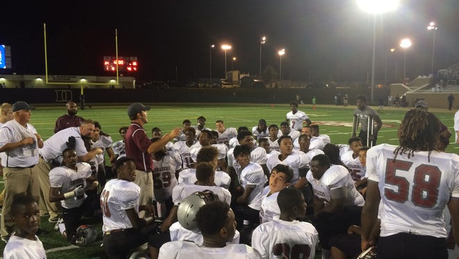 Liberty head coach Tyler Turner talks to the Crusaders after their most dramatic win of the season at Dyersburg.