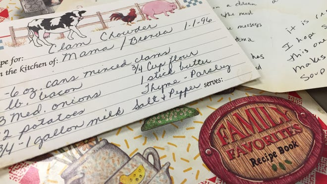 A recipe card my mom wrote and gave to a friend of mine, a book of recipes handwritten by my mom for the same friend and a card that friend mailed me.