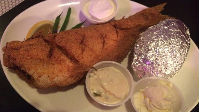 Whole catfish breaded in cornmeal