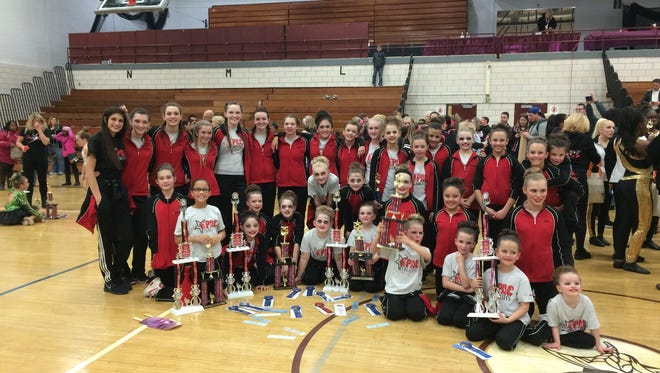 Starlites Competitive Dance Teams poses with their trophies after the Showcase America Unlimited Dance Competition.