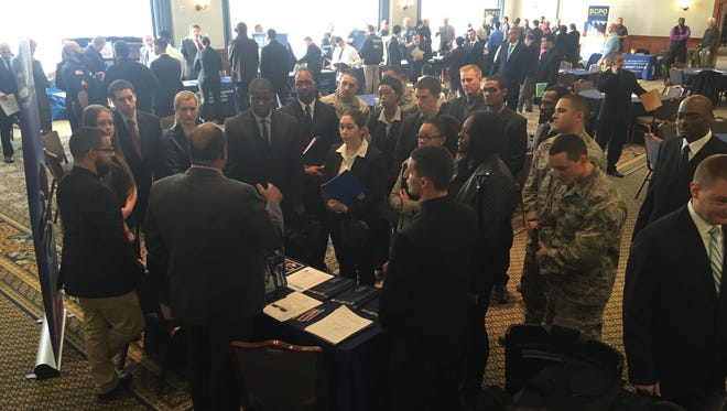 A U.S. Drug Enforcement Administration representative speaks to visitors at a Gloucester County Prosecutor's Office-sponsored-fair meant to encourage diversity in law enforcement.