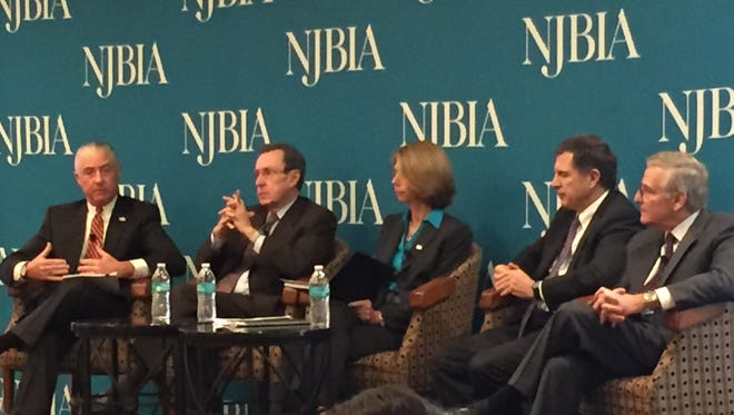 A panel discusses obstacles to New Jersey's long-term economic growth Tuesday at a forum hosted by the New Jersey Business and Industry Association. (Left to right) Walter Brasch, president, N.J. Society of CPAs; James Hughes, economist, Rutgers University; Michele Siekerka, president and CEO, New Jersey Business and Industry Association; Michael McBride, managing partner, Connell Foley; and Joel Naroff, NJBIA chief economic adviser.