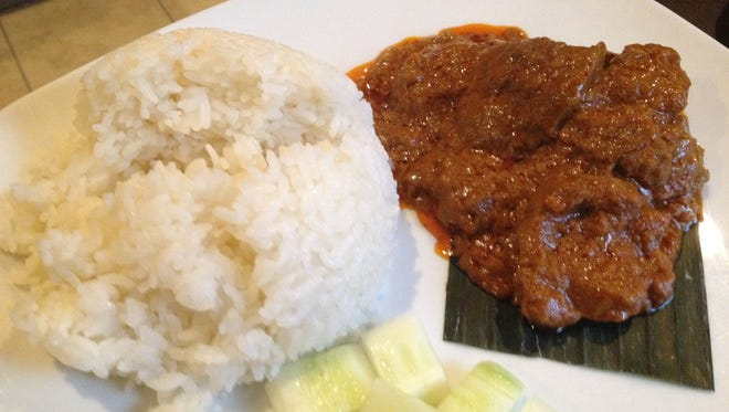 The beef rendang looks simple but it contains a great complexity of flavors.