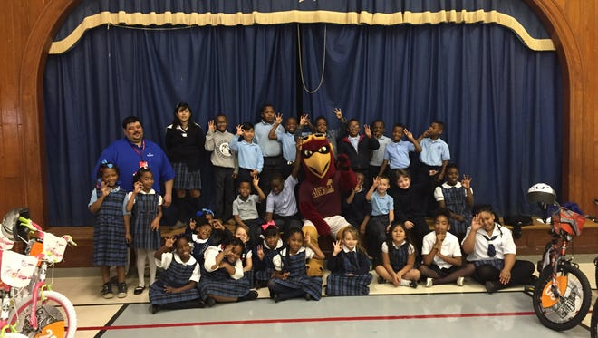 Thirty students at Our Lady of Fatima School won new bikes Wednesday morning. Academy Sports + Outdoors provided the bikes and helmets.