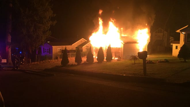 Flames consume a detached garage with stored ammunition early Wednesday morning on Chesapeake Drive in the Lake Hiawatha section of Parsippany.