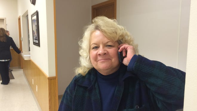 Maine Town Chairwoman Betty Hoenisch talks on the phone after the votes were tallied Tuesday, Dec.  8, 2015, on a referendum asking residents to approve turning the town into a village to cope with a financially insolvent neighbor.
