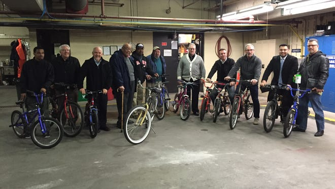 Members of Blue Water Area Churches accept recovered bicycles Thursday, Dec. 10, 2015, from the Port Huron Police Department.