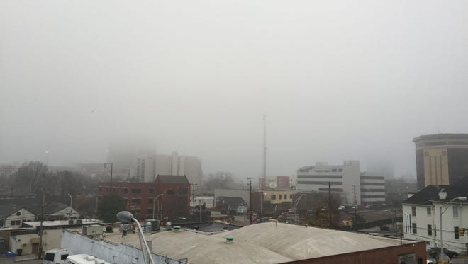 Part of the downtown skyline is missing in this view from a Music Row balcony Thursday morning.