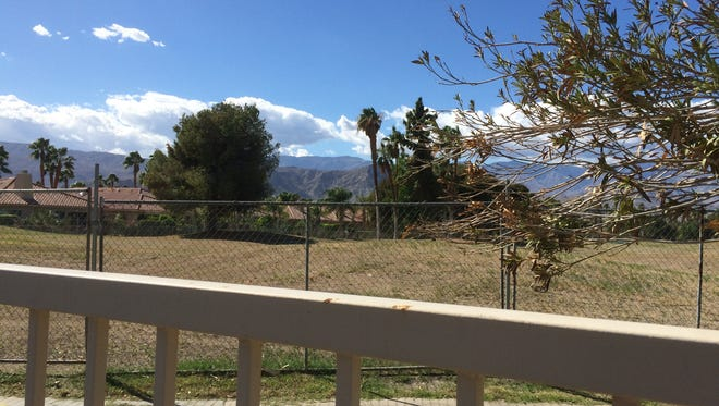 A chain-link fence around the Rancho Mirage Country Club golf course is at the center of a legal dispute.