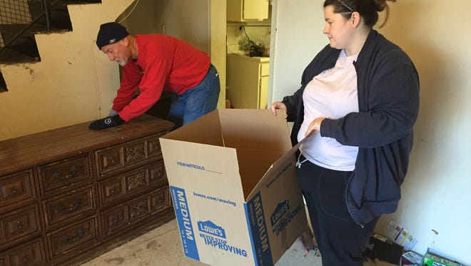 Belle Aire Baptist member Bucky Phillips, left, helps Franklin Heights resident Karen Anderson move from her unit.