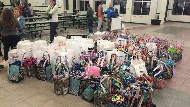 Bags filled with fleece blankets tied by current and former Woodland Intermediate School students. The blankets will be given to cancer patients and their families.