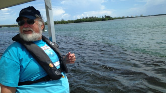 Dennis Hanisak, a research professor at FAU-Harbor Branch Oceanographic Institute, monitors lagoon water quality from solar-powered, real-time monitors fastened to channel markers near Fort Pierce Inlet.
