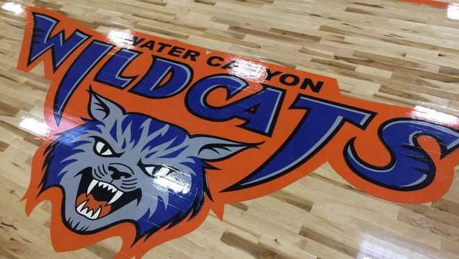 The logo for the Water Canyon Wildcats is displayed on the floor of the school's new gym. The Hildale school fielded its first boys and girls basketball teams last week.