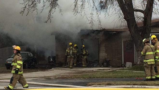 Town of Menasha firefighters responded to a home after smoke and flames were coming from the adjoining garage.