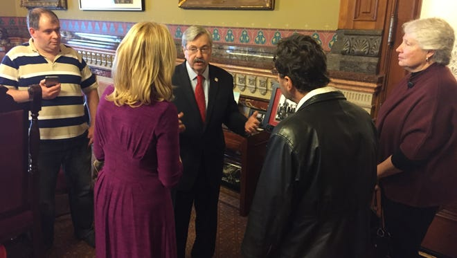 Iowa Gov. Terry Branstad talks Monday with well-wishers at a public open house in his office at the State Capitol to commemorate his record 7,642nd day in office.