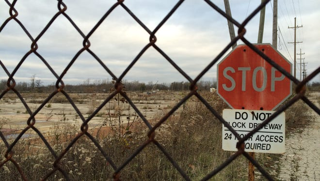 The gate at the former Indiana Steel and Wire property, where officials hope a shell building, part of a proposed industrial redevelopment, might spark growth.