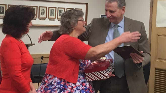 As Mayor Sherry Capello (left) watches, Lebanon Councilwoman Pat Royer and Councilman Wiley Parker prepare to hug after Royer was honored at her last council meeting Monday night.